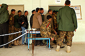 SULAIMANIYAH, IRAQ; Policemen vote in Sulaimaniyah..Three days before the polls open, military and convicts vote in the Iraqi Parliamentary Elections....Photo by Sartip Othman/ Metrography