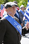 Greek Parade in New York City. An older man in a hat proudly holds a Greek flag in the Greek Parade in New York City.