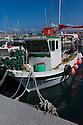 Santorini, Greece. 05.05.2014. Typical Greek fishing boats in the harbour, Vlychada, Santorini, Greece. Photograph © Jane Hobson.