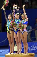 Oct 01, 2000; SYDNEY, AUSTRALIA:<br /> (L-R)Yulia Raskina (BLR) silver medal, Yulia Barsoukova (RUS) gold, Alina Kabaeva (RUS) bronze celebrate during rhythmic gymnastics medals ceremony at 2000 Summer Olympics.