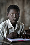 A boy in a classroom in Detang, a small village across the Upper Nile River from Malakal, in Southern Sudan. Teachers in this school are participating in a training program run by Solidarity with Southern Sudan, an international network of Catholic groups supporting Southern Sudan with educational personnel and prayer.
