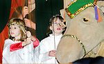 LITCHFIELD, CT. 07  January  2006-010806SV06--From left, Abigail Yanaway, 6, and Claire Ryan, 6, of Litchfield hold up a puppet during a family entertainment day at St Michael's church in Litchfield. The church school used the colossal puppets in a pagent at the church Sunday.<br />  Steven Valenti / Republican-American