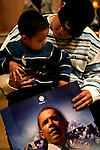 Las Vegas, Nevada, USA, 20080119:   Employees at the Caesar Casino and Hotel attending caucus at their hotel...Edgar Jesus Sanchez (2) on the lap of his uncle Jaime Orozco (25) on the Obama bench...Photo: Orjan F. Ellingvag/ Dagens Naringsliv/ Corbis