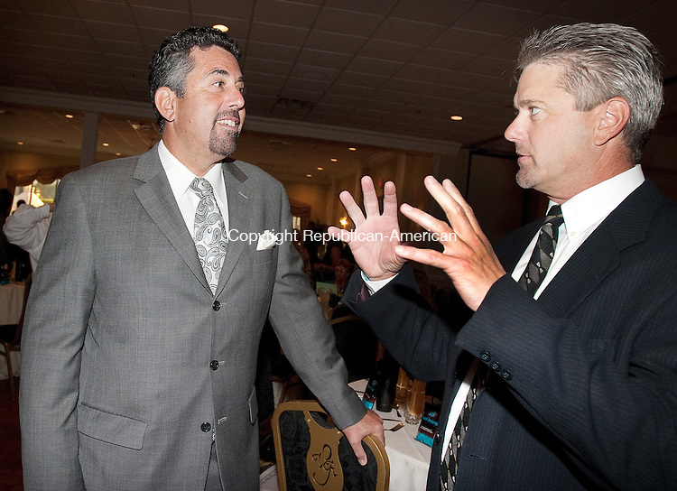 WATERBURY, CT. 01 September 2010-090110SV01--From left, Joe Gugliotti, The Worx Group, and Peter Baker, Crystal Rock, talk before the United Way of Greater Waterbury annual campaign kick off breakfast at Villa Rosa in Waterbury Wednesday. They are the 2010-11 campaign co-chairs.<br /> Steven Valenti Republican-American