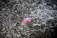 Oslo, Norway, 26.07.2011. A small Norwegian plastic flag floats in a fountain in Oslo. After the rose parade 25.th of july, Oslo wakes up covered in roses. More than 200.000 roses decorated the city. Foto: Christopher Olssøn.