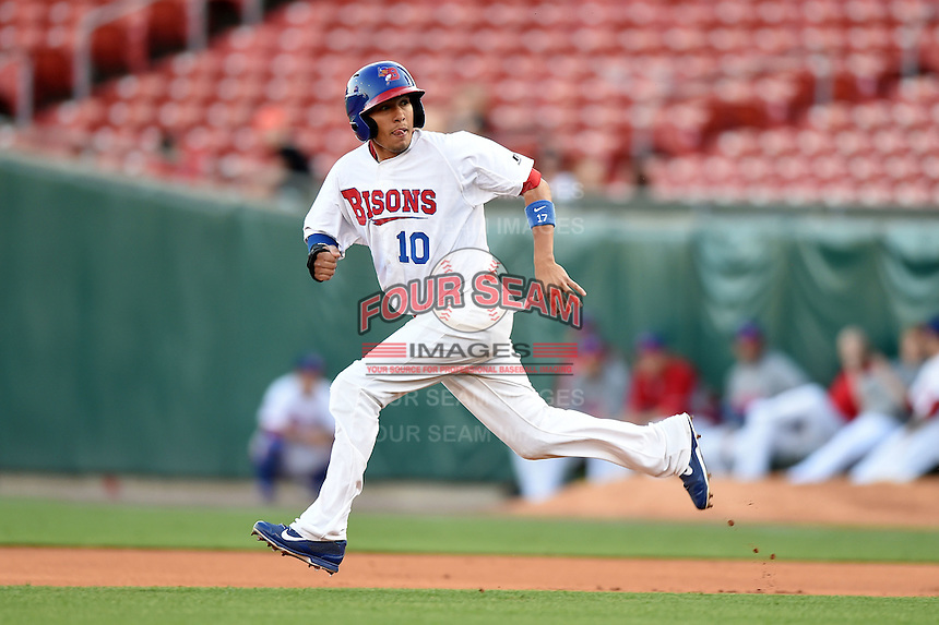 Buffalo Bisons second baseman Ryan Goins (10) looks to the batters box on a hit and run during a game against the Durham Bulls on July 10, 2014 at Coca-Cola Field in Buffalo, New  York.  Durham defeated Buffalo 3-2.  (Mike Janes/Four Seam Images)