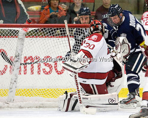 John Henrion (UNH - 16), Raphael Girard (Harvard - 30), Grayson Downing (UNH - 28) - The Harvard University Crimson defeated the University of New Hampshire Wildcats 7-6 on Tuesday, November 22, 2011, at Bright Hockey Center in Cambridge, Massachusetts.