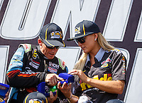 Sep 18, 2016; Concord, NC, USA; NHRA top fuel driver Leah Pritchett (right) and Clay Millican during the Carolina Nationals at zMax Dragway. Mandatory Credit: Mark J. Rebilas-USA TODAY Sports