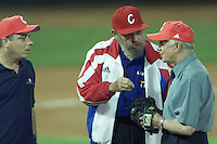 Former U.S. President Jimmy Carter talks with Cuban President Fidel Castro after a friendly game of baseball Cuba against U.S at the 'Latinoamericano' stadium in Havana, May 14, 2002. Carter's visit, the most important by an American since President Fidel Castro took power in a 1959 revolution, is an attempt to bridge four decades of Cold War feuding between Washington and Havana.. Credit: Jorge Rey/MediaPunch