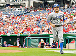 5 September 2011: Los Angeles Dodgers infielder Jamey Carroll trots back to the dugout after scoring the first run of the game in the first inning against the Washington Nationals at Nationals Park in Los Angeles, District of Columbia. The Nationals defeated the Dodgers 7-2 in the first game of their 4-game series. Mandatory Credit: Ed Wolfstein Photo