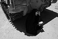 Falluja, Iraq, June 6, 2003.Alahem Salman is without news from her son Ayad Kudhayr  born in 1979 since the second day of the war; she came to one US troops position in the vain hope to receive some information....
