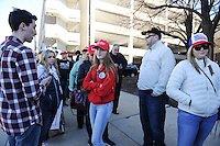 Supporters of Republican Presidential front runner Donald Trump wait in line on the University of Illinois Chicago (UIC) campus to hear Trump speak at an event scheduled for the early evening in Chicago, Illinois on March 11, 2016.  Trump cancelled the event citing a request from the Chicago Police after scuffles broke out between his supporters and protesters, who had claimed a large number of the seats, before he was to speak, something the Chicago Police denied, which maintain they were ready to work the whole night.
