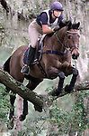 Victoria Jessup, riding L'Cedric,  looks ahead as they clear a Live Oak limb called the &quot;Over the Agarista&quot; jump which was part of the preliminary course at the Red Hills Horse Trials in Tallahassee, Florida..