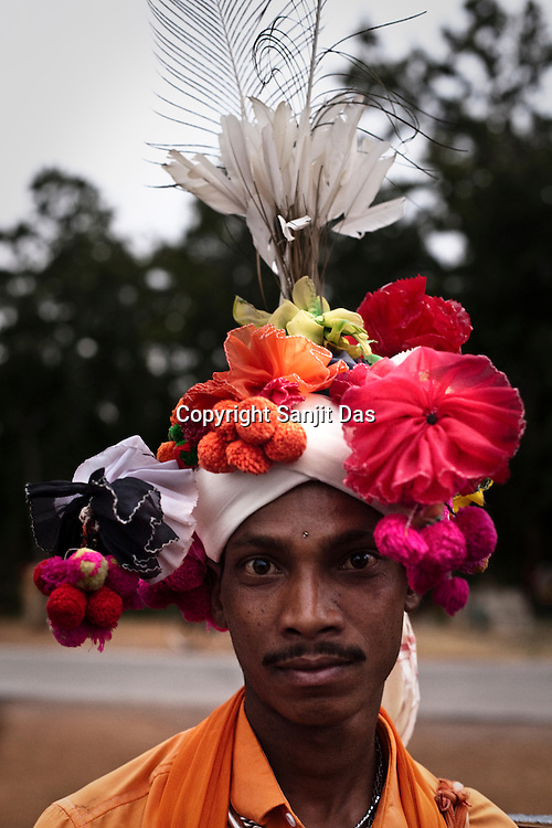 A Gond tribesman, Samlu Ram Netam poses for a portrait with a traditional turban during a festival celebration in Chattisgarh, India. Photo: Sanjit Das/Panos for Forbes