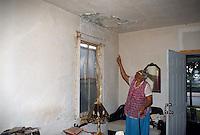 1995 May ..Conservation.Lamberts Point...Slum Conditions.1st floor Interior. crippled elderly woman at.3711 Bowden Ferry Road...NEG#.NRHA#..CONSERV: Lambert2 4:8