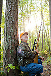 "Steve ""Wildman"" Wilson, with the Arkansas Game and Fish Commission, squirrel hunting in the Ouachita National Forest outside of Little Rock, Arkansas."