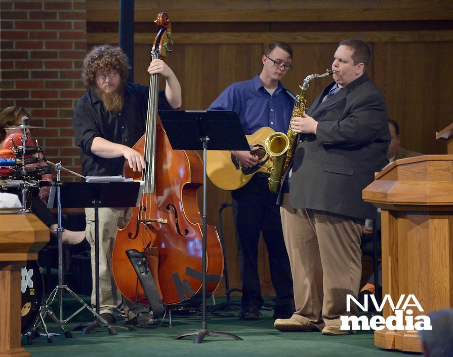 NWA Democrat-Gazette/BEN GOFF @NWABENGOFF<br /> Michael Lavender, on bass, Max Richards on guitar and Matt Schatz on saxophone play as part of a jazz quintet on Sunday Feb. 7, 2016 during the Jazz Communion service at First Presbyterian Church in Bentonville.