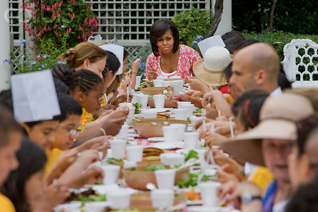 16 Jun 2009, Washington, DC, USA --- First lady Michelle Obama shares a meal made with vegetables she harvested from her garden with the help of local Bancroft Elementary School children at the White House in Washington.  --- Image by © Brooks Kraft/Corbis
