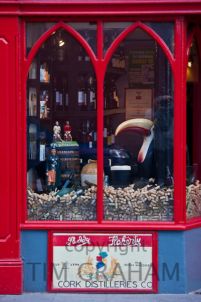 Toucan bird and display of corks in front window of Treacy's Bar in Youghal, County Cork, Ireland