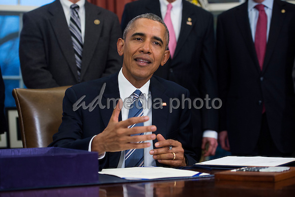 United States President Barack Obama, with lawmakers and supporters of the bill, signs H.R. 644, the Trade Facilitation and Enforcement Act of 2015 during a ceremony in the Oval Office of the White House in Washington, DC, USA, 24 February 2016.  From left to right behind the President: Gil Kerlikowske, Commissioner of U.S. Customs and Border Protection; US Representative Earl Blumenauer (Democrat of Oregon); US Representative Eddie Johnson (Democrat of Texas); US Representative David Reichert (Republican of Washington); US Senator Orrin Hatch (Republican of Utah); US Senator Michael Bennet (Democrat of Colorado); US Representative Ron Kind (Democrat of Wisconsin); and US Trade Representative Michael Froman. Photo Credit: Shawn Thew/CNP/AdMedia