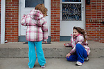 """Kendrick Brinson.LUCEO..Sloan Olson, 3, plays with her sister Tatiana, 6, outside of her family's apartment in January in oil boom-town Williston, North Dakota. Her grandmother Peggy Adrin said the town has """"really changed a lot"""" since she first moved there 30 years ago. """"When we first moved here, there was nothing,"""" she said. Williston, North Dakota is currently experiencing an influx of people relocating there for the town's third oil boom...Model Released: Yes.Assigning Editor: Michael Wichita."""