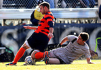 WASHINGTON, DC - NOVEMBER 25, 2012: Andy Riemer (20) of Georgetown University tackles Chris Makowski (20) of Syracuse University during an NCAA championship third round match at North Kehoe field, in Georgetown, Washington DC on November 25. Georgetown won 2-1 after overtime and penalty kicks.
