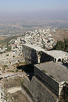 Hill town beneath Krak des Chevaliers, Qala'at al-Husn, Crusader castle, 1110-1271, Homs Gap, Syria Picture by Manuel Cohen