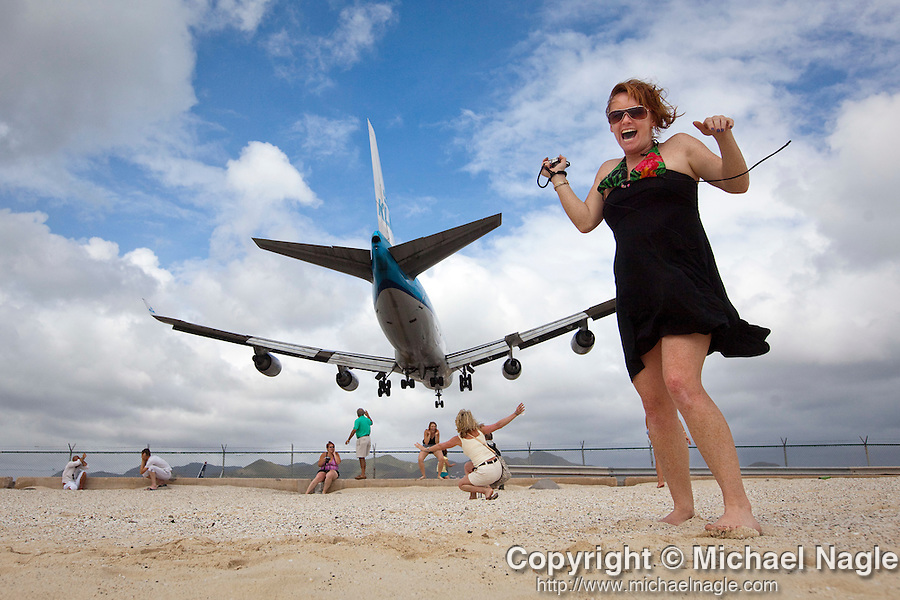 ST MARTIN --  MAY 05, 2009:  Tara Patience is blasted with jet exhaust on Maho Beach as a KLM 747 plane lands at Princess Juliana Airport on May 05, 2009 in St Martin.  (PHOTOGRAPH BY MICHAEL NAGLE)