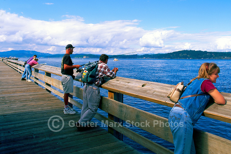 """Fishing on """"Discovery Pier"""", overlooking Discovery Passage, in Campbell River, Vancouver Island, British Columbia, Canada"""