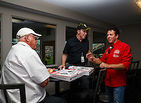 Sep 3, 2016; Clermont, IN, USA; Papa Johns pizza founder John Schnatter (right) talks with NHRA president Peter Clifford (center) and official Graham Light during qualifying for the US Nationals at Lucas Oil Raceway. Mandatory Credit: Mark J. Rebilas-USA TODAY Sports