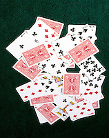 PLAYING CARDS: DISORDERED PILE ABOUT HALF FACE UP<br />