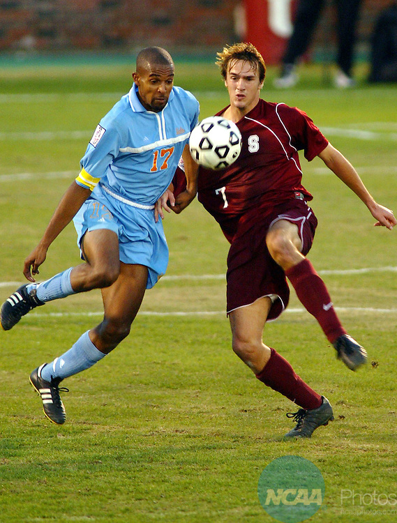 15 DEC 2002:  Scot Thompson (17) and Roger Levesque (7) of Stanford race to the ball during the Division I Men's Soccer Championship held at Gerald J. Ford Stadium on the campus of Southern Methodist University in Dallas, TX.  UCLA defeated Stanford 1-0 for the championship title.  Paul Buck/NCAA Photos