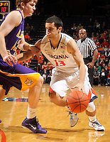 Jan. 2, 2011; Charlottesville, VA, USA; Virginia Cavaliers guard Sammy Zeglinski (13) drives past LSU Tigers forward Eddie Ludwig (13) during the game at the John Paul Jones Arena. Virginia won 64-50. Mandatory Credit: Andrew Shurtleff-