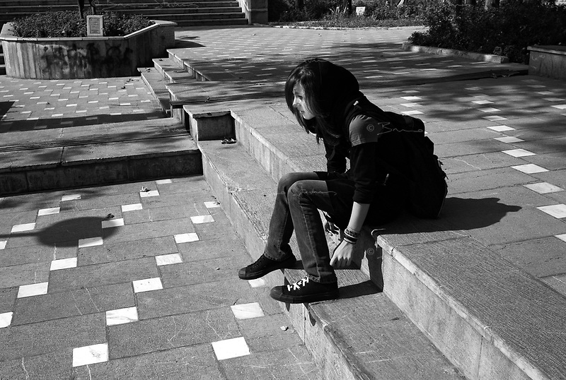 "Teheran, Iran, October 10, 2007.Young ""underground"" artists in a northern Teheran park. Hoping for a more 'western' lifestyle, they meet up to discuss for hours in the city parks."