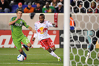 Dane Richards (19) of the New York Red Bulls is defended by Servando Carrasco (23) of the Seattle Sounders. The New York Red Bulls defeated the Seattle Sounders 1-0 during a Major League Soccer (MLS) match at Red Bull Arena in Harrison, NJ, on March 19, 2011.