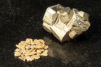 IRON PYRITE AND GOLD COMPARISON<br /> (Variations Available)<br /> Gold nuggets compared to &quot;Fool's Gold&quot;<br /> The mineral iron pyrite has a simple cubic structure. It is also known as iron sulfide (FeS2) or Fool's Gold because of its similar lustre to gold. Gold (Au) is a malleable and ductile transition metal. Pyrite is sometimes found in association with gold.