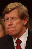 Washington, D.C. - April 13, 2004 --  United States Solicitor General Theodore &quot;Ted&quot; Olsen grimaces as Attorney General John Ashcroft testifies before the National Commission on Terrorist Attacks Upon the United States (the 9-11 Commission) in Washington, DC on April 13, 2004.  Olsen lost his wife, Barbara, in the hijacking of American Airlines flight 77 that crashed into the Pentagon on September 11, 2001.<br /> Credit: Ron Sachs / CNP<br /> [RESTRICTION: No New York Metro or other Newspapers within a 75 mile radius of New York City]