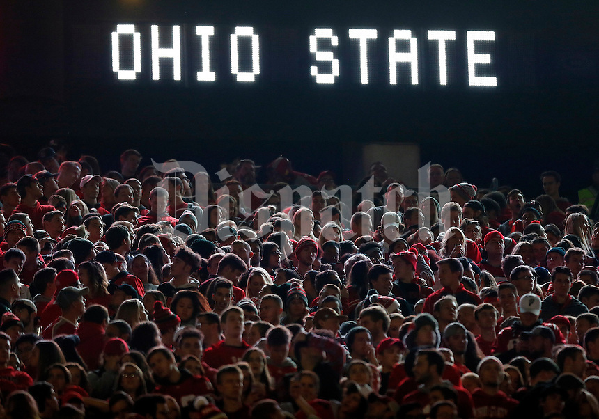 Ohio State Buckeyes students are illuminated by the scoreboard during the second quarter of the NCAA football game against the Nebraska Cornhuskers at Ohio Stadium in Columbus on Nov. 5, 2016. Ohio State won 62-3. (Adam Cairns / The Columbus Dispatch)