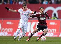 FUSSBALL   1. BUNDESLIGA  SAISON 2012/2013   12. Spieltag 1. FC Nuernberg - FC Bayern Muenchen      17.11.2012 Bastian Schweinsteiger (li, FC Bayern Muenchen) GEGEN Markus Feulner (1 FC Nuernberg)