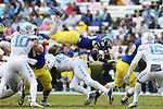 26 September 2015: Delaware's Kareem Williams (32) is flipped into the air by UNC's Shakeel Rashad (42). The University of North Carolina Tar Heels hosted the University of Delaware Blue Hens at Kenan Memorial Stadium in Chapel Hill, North Carolina in a 2015 NCAA Division I College Football game. UNC won the game 41-14.