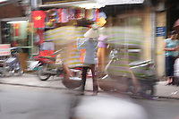 Hanoi<br /> , Vietnam - 2007 File Photo -<br /> <br /> woman vendor on streets abstract view.<br /> <br /> <br /> <br /> <br /> photo : James Wong-  Images Distribution