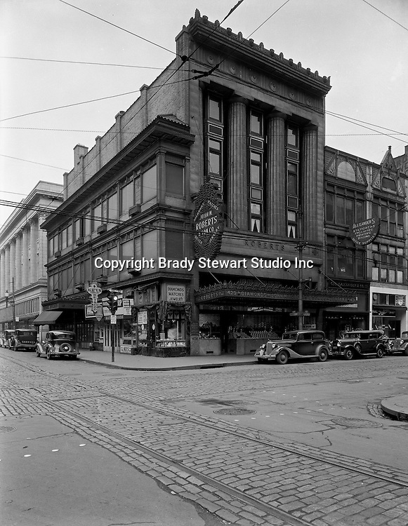 Pittsburgh PA:  View of the corner of Diamond and Wood Streets - 1936.  Founded in 1832 in a log cabin, John M. Roberts &amp; Son Co. moved to Wood and Diamond streets in 1925. Mr. Roberts was the fourth generation of his family to work in the business. Owners often said it was the oldest emporium in Pittsburgh, the first to use lighting in its display windows, and proudly boasted of customers such as George Westinghouse, railroad financier and philanthropist Diamond Jim Brady, singer Lillian Russell and pianist Liberace.<br />