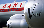 "John Travolta's jumbo jet. V-JET inscription...John Travolta is pilot of his very own jumbo jet, a 1964 Boeing 707-100 series. In 2003, John Travolta flew his jumbo jet around the world, in partnership with Quantas, to rekindle confidence in commercial aviation, and to remind us that elegance and style are a part of flying. The crew are dressed in tailor made authentic uniforms from the Quantas museum. The men's uniforms are styled on British Naval uniforms and the ladies' designed by Chanel. His jumbo jet sports a personalised number plate N707JT which speaks for itself. The aircraft is named ""Jett Clipper Ella"" dedicated to his son and daughter. This jumbo together with his other aircraft are housed in purpose built hangars at his home in Florida, USA."
