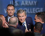 "CARLISLE, PA - MAY 24: U.S. President George W. Bush greets military personnel after making remarks on ""Iraq and the War on Terror"" during a nationally broadcast speech at the U.S. Army War College May 24, 2004 in Carlisle, Pennsylvania. The speech is said to be one in a series of speechs the President intends to give on the situation in Iraq and the war on terror. (Photo by William Thomas Cain/Getty Images)"