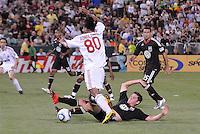 AC Milan forward Ronaldinho (80) tries to get by DC United midfielder Devon Mctavish (18) DC United defeated AC. Milan 3-2 at RFK Stadium, Wednesday May 26, 2010.