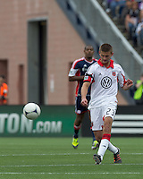DC United defender Perry Kitchen (23) passes the ball. In a Major League Soccer (MLS) match, DC United defeated the New England Revolution, 2-1, at Gillette Stadium on April 14, 2012.