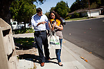 Republican congressional candidate Ricky Gill, left, and campaign volunteer Stephanie Freedman look at voter information on a tablet while canvassing in Stockton, Calif., September 18, 2012.