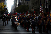 Military members and war veterans take part in the annual Veterans Day parade in New York.  10.11.2014. Gary Hershorn/VIEWpress
