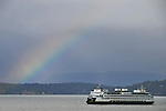 A rainbow arcs over a Washington State Ferry as it passes through the San Juan Islands, WA