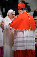 Canadian cardinal Gerald Cyprien Lacroix   is congratulated by Pope emeritus Benedict XVI  after he was appointed cardinal by the Pope at the consistory in the St. Peter's Basilica at the Vatican on February 22, 2014.